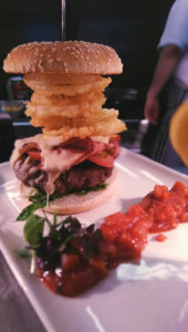Stacked burger with tomato bacon onion rings