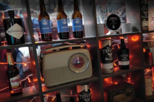 Old radio in front of craft beers and spirits at Harrison Bar & Restaurant Cliffoney