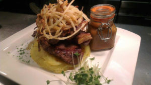 Steak on mash with tobacco fries on top at Harrisons Restaurant Cliffoney