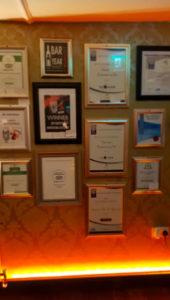 Awards won on wall at Harrisons Bar & Restaurant Cliffoney