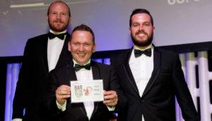 Declan Harrison & team holding winner bar of year awards