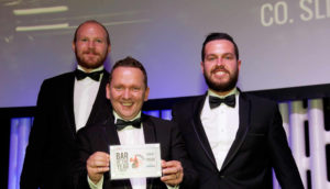 Declan Harrison & team holding winner bar of year awards