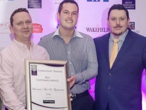 Declan Harrison & staff holding Best Customer Service award