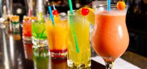 cocktails lined up on bar