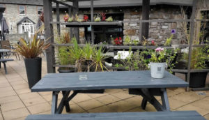 outside table and chairs on patio at Harrisons Bar & Restaurant Cliffoney