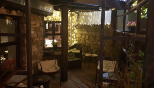 Comfy chairs on patio outside at Harrisons Bar & Restaurant Cliffoney